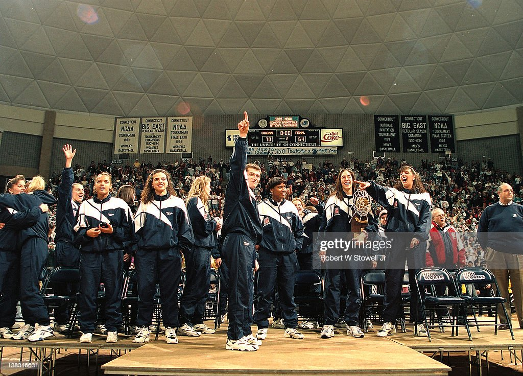 Members of the University of Connecticut women's basketball team celebrate at a pep rally in their honor following their victory at the 1995 National Championship, Storrs, Connecticut, 1995. Among those pictured are, from left, Missy Rose, Brenda Marquis, coach <a gi-track='captionPersonalityLinkClicked' href=/galleries/search?phrase=Geno+Auriemma&family=editorial&specificpeople=704607 ng-click='$event.stopPropagation()'>Geno Auriemma</a>, Jamelle Elliott, <a gi-track='captionPersonalityLinkClicked' href=/galleries/search?phrase=Rebecca+Lobo&family=editorial&specificpeople=221573 ng-click='$event.stopPropagation()'>Rebecca Lobo</a>, and Kara Wolters.