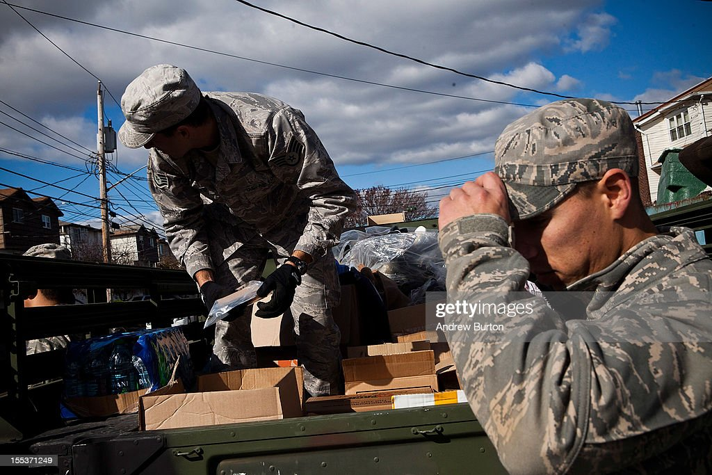 Members of the US Air Force National Guard hand out supplies including food, water and clothing in the Midland Beach neighborhood of Staten Island on November 3, 2012 in New York City. As clean up efforts from Superstorm Sandy continue, colder weather and another storm predicted for next week are beginning to make some worried.