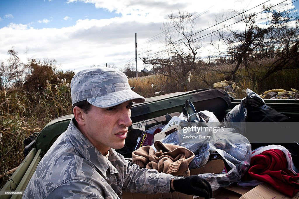 Members of the US Air Force National Guard patrol the Midland Beach neighborhood of Staten Island, looking for those in need of food, water or clothing, on November 3, 2012 in New York City. As clean up efforts from Superstorm Sandy continue, colder weather and another storm predicted for next week are beginning to make some worried.