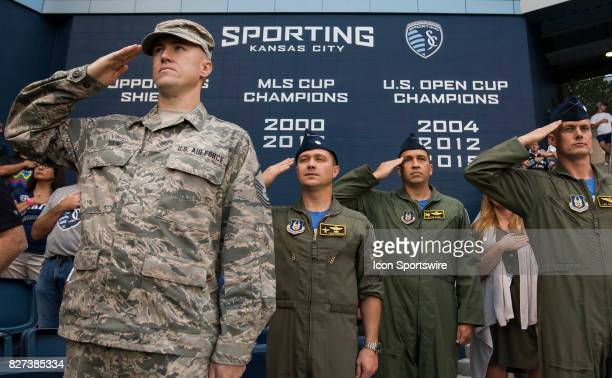 Members of the US Air Force salute during the National Anthem and military appreciation day before the match between Sporting Kansas City and Atlanta...