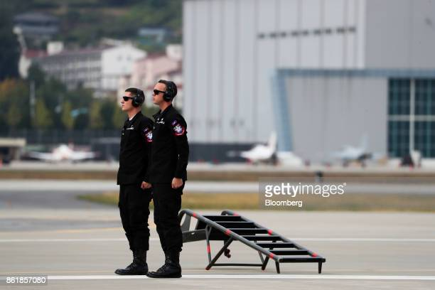 Members of the US Air Force stand on the tarmac during a press day of the Seoul International Aerospace Defense Exhibition at Seoul Airport in...
