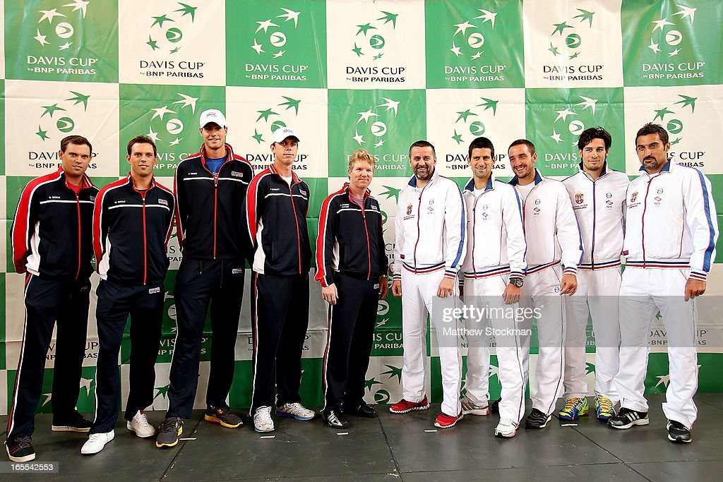 Members of the US and Serbian Davis Cup teams pose for photographers (L to R) Bob Bryan, Mike Bryan John Isner, Sam Querrey, Captain Jim Courier, Captain Bogdan Obradovic, Novak Djokovic, Viktor Troicki, Ilija Bozoljac, Nenad Zemonjic during the draw ceremony at the Boise Depot on April 4, 2013 in Boise, Idaho.