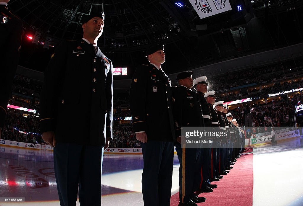 Members of the US Armed Services line up in the ice as part of military appreciation night prior to the game Colorado Avalanche against the St Louis Blues at the Pepsi Center on April 21, 2013 in Denver, Colorado.