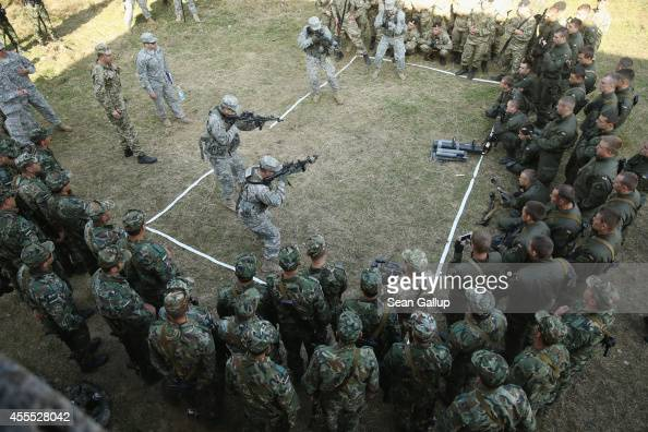 Members of the US Army 173rd Airborne Brigade demonstrate urban warfare techniques as Bulgarian and Ukrainian soldiers look on on the second day of...