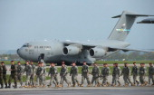 Members of the US Army 173rd Airborne Brigade disembark upon their arrival by plane at a Polish air force base on April 23 2014 in Swidwin Poland...