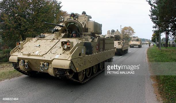 Members of the US Army 1st Brigade 1st Cavalry Division drive Bradley Fighting Vehicles from the railway station near the Rukla military base in...