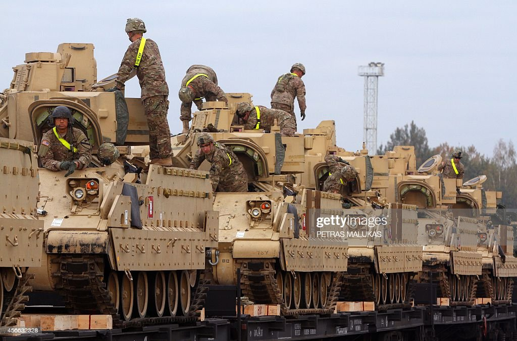 Members of the US Army 1st Brigade 1st Cavalry Division transport heavy combat equipment including Bradley Fighting Vehicles at the railway station...