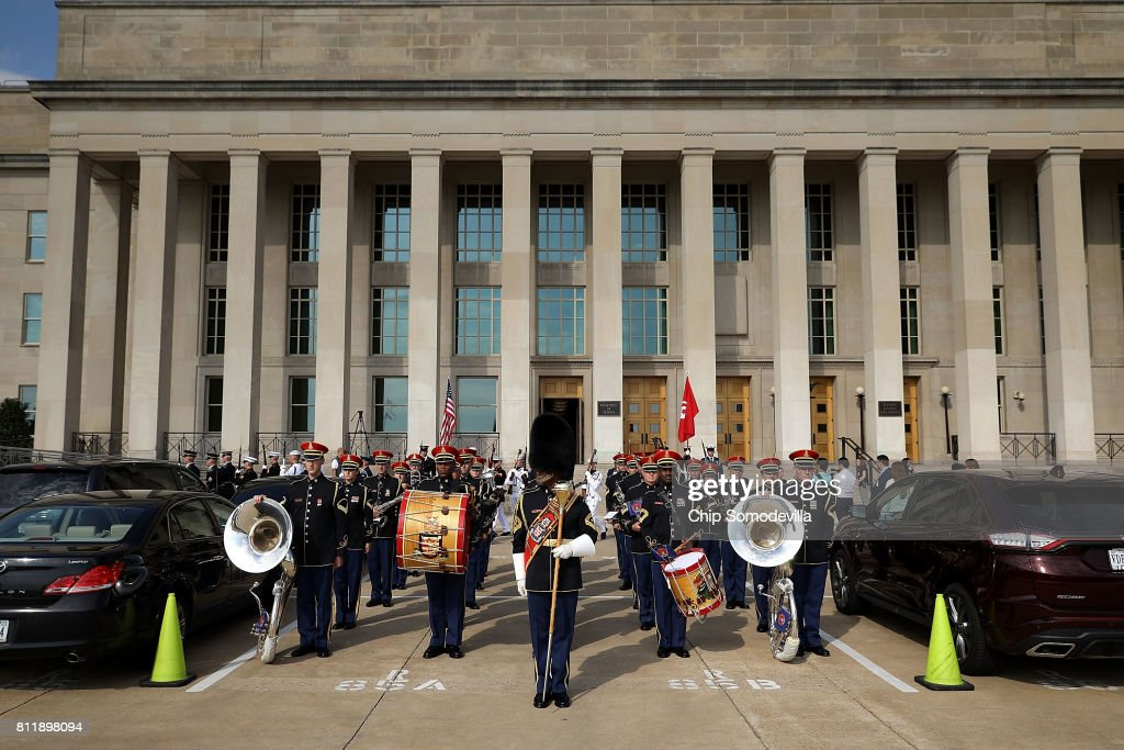 Members of the U.S. Army Band leave after performing during an honor cordon with U.S. Secretary of Defense James Mattis and Tunisian Prime Minister Youssef Chahed at the Pentagon July 10, 2017 in Arlington, Virginia. Chahed will participate in bilateral meetings with Vice President Mike Pence later in the day.