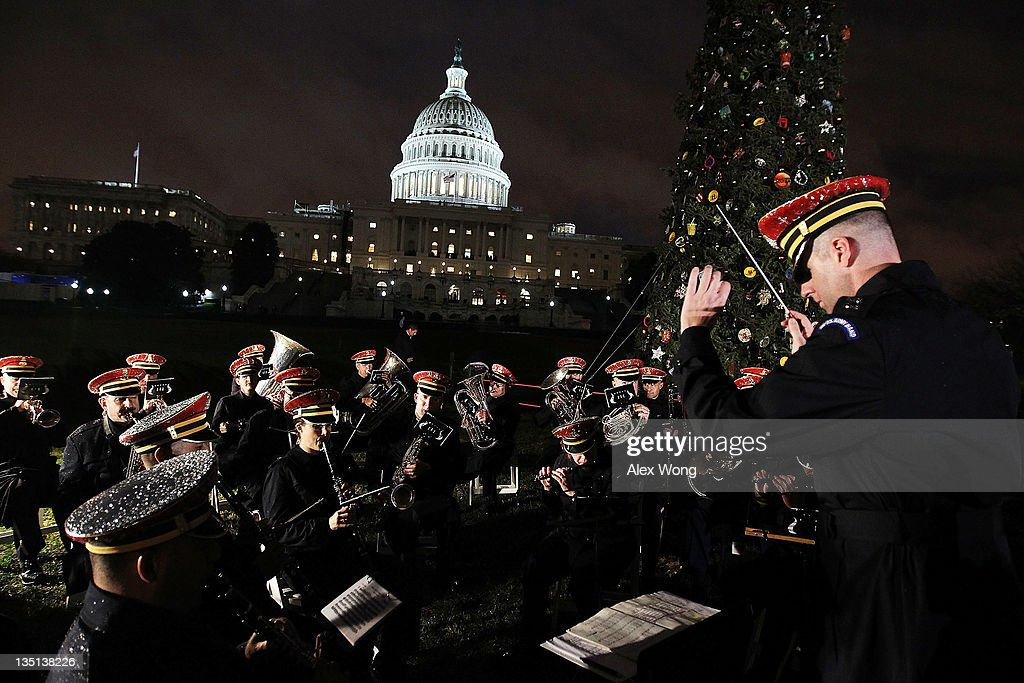 Members of the U.S. Army Band 'Pershing's Own' perform during the lighting ceremony of the 2011 Capitol Christmas Tree at the West Front of the Capitol December 6, 2011 on Capitol Hill in Washington, DC. This year's tree was a 65-foot tall Sierra white fir from the Stanislaus National Forest in California.