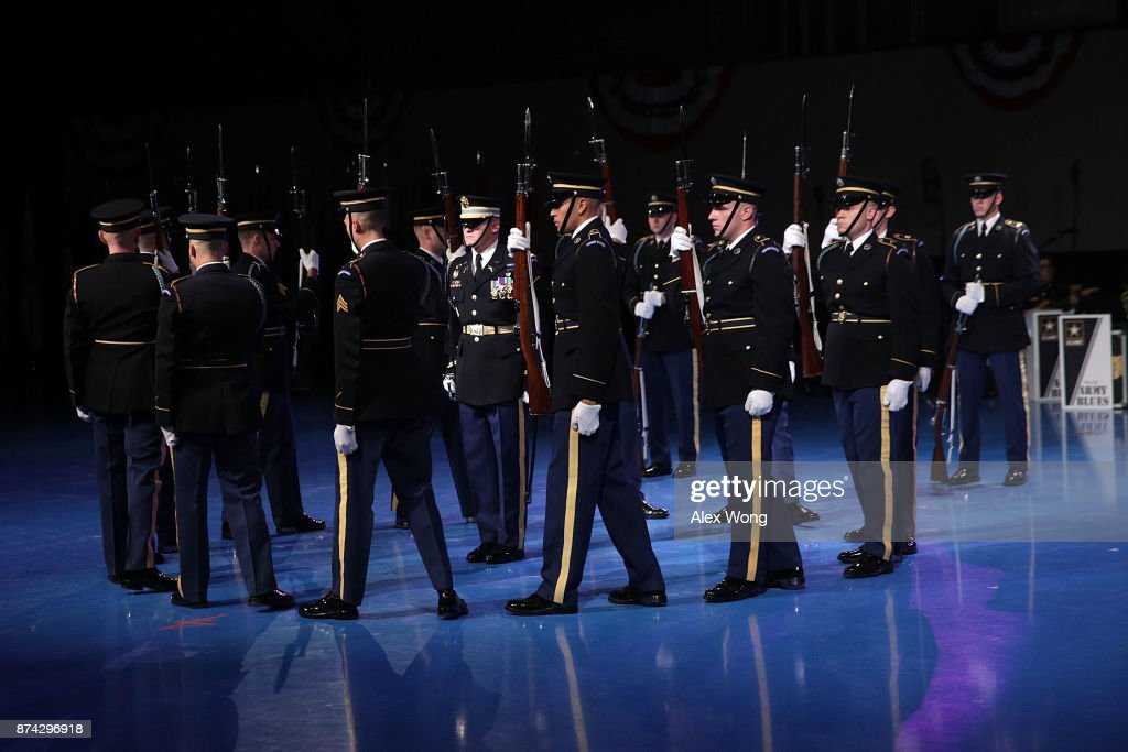 Members of the U.S. Army Drill Team perform during a special Twilight Tattoo performance November 14, 2017 at Fort Myer in Arlington, Virginia. U.S. Sen. John McCain (R-AZ) was honored with the Outstanding Civilian Service Medal for over 63 years of dedicated service to the nation and the U.S. Navy.