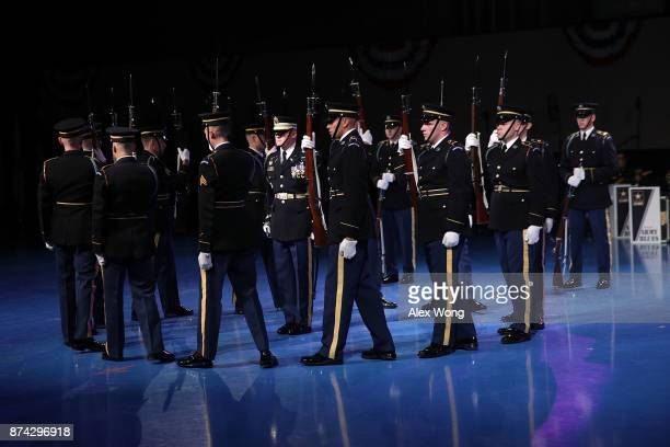 Members of the US Army Drill Team perform during a special Twilight Tattoo performance November 14 2017 at Fort Myer in Arlington Virginia US Sen...