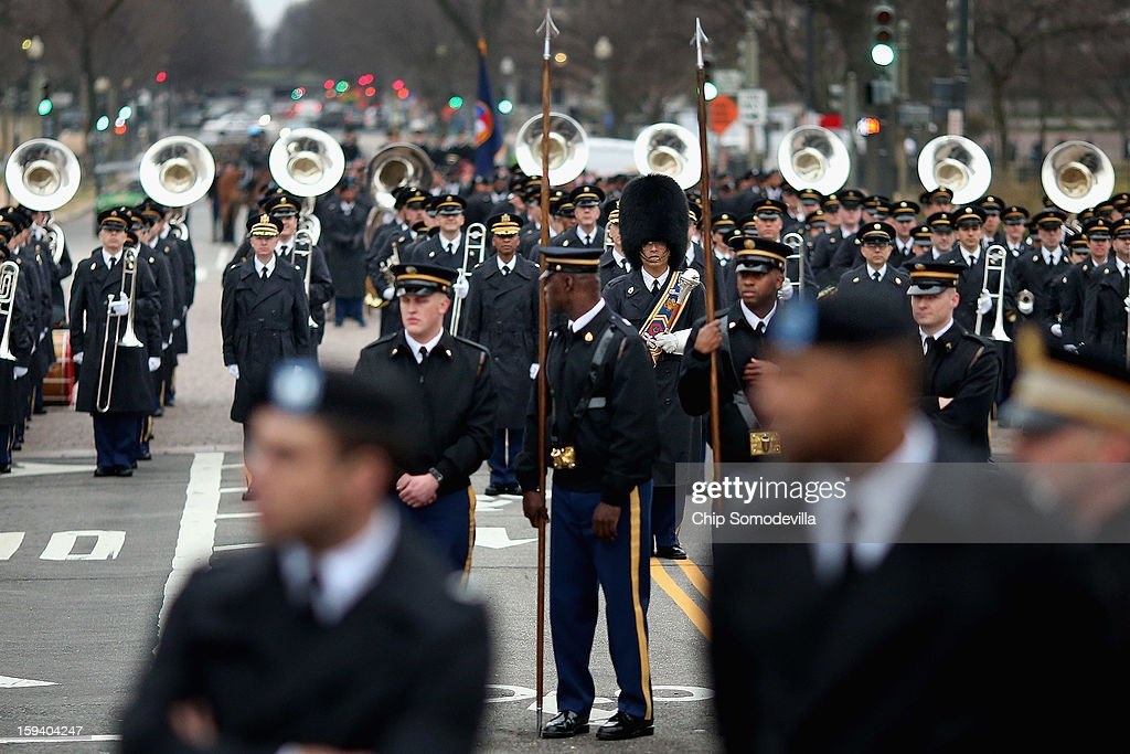 Members of the U.S. Army Field Band out of Fort Meade, Md stand ready along Pennsylvania Avenue during a dress rehersal for the Presidential Inaugural parade January 13, 2013 in Washington, DC. President Barack Obama and Vice President Joe Biden will be ceremonially sworn in for a second four-year term during the 57th Inauguration on January 21.