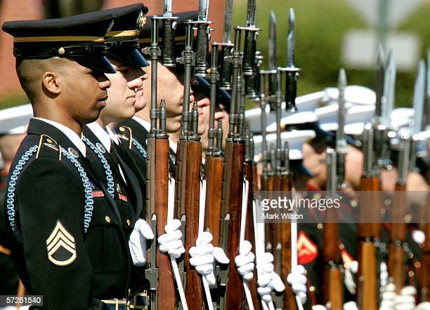 Members of the US Army Honor Guard stands in formation during the funeral for Caspar W Weinberger at Arlington National Cemetery April 4 2006 in...