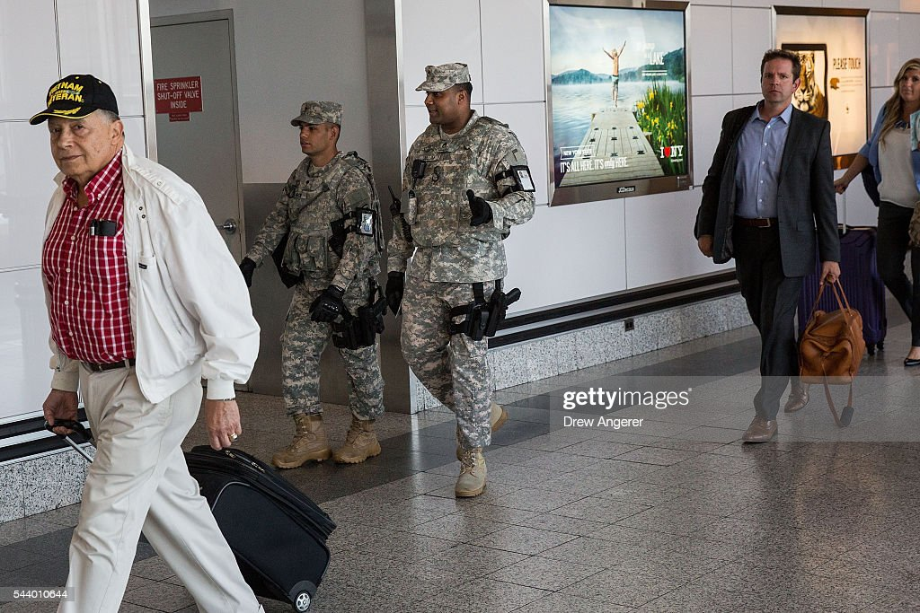 Members of the U.S. Army patrol along a concourse in the departures area at LaGuardia Airport (LGA), June 30, 2016 in the Queens borough of New York City. Following Tuesday's terrorist attacks at Instanbul's Ataturk Airport, the Transportation Security Administration and other law enforcement agencies have increased security at major airports in the United States.