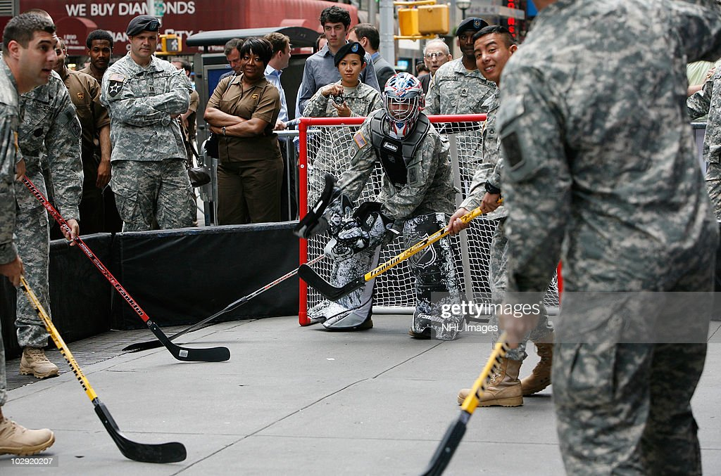 Members of the US Army play street hockey with equipment donated to troops in Iraq at the NHL Powered by Reebok Store on June 7, 2010 in New York.
