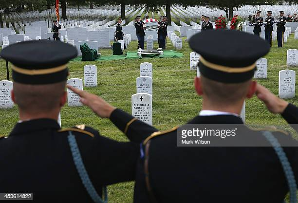 Members of the US Army salute as the casket of US Army Maj Gen Harold J Greene is carried to the gravesite during a full honors funeral service at...