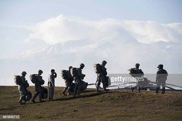 Members of the US Army's 4th Infantry Brigade Combat Team 25th Infantry Division part of the NATOled peacekeeping mission in Kosovo take part in a US...