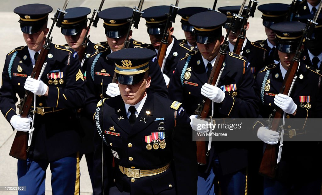 Members of the US Army's Old Guard take part in a wreath laying ceremony at the Tomb of the Unknown Soldier at Arlington National Cemetery June 13...