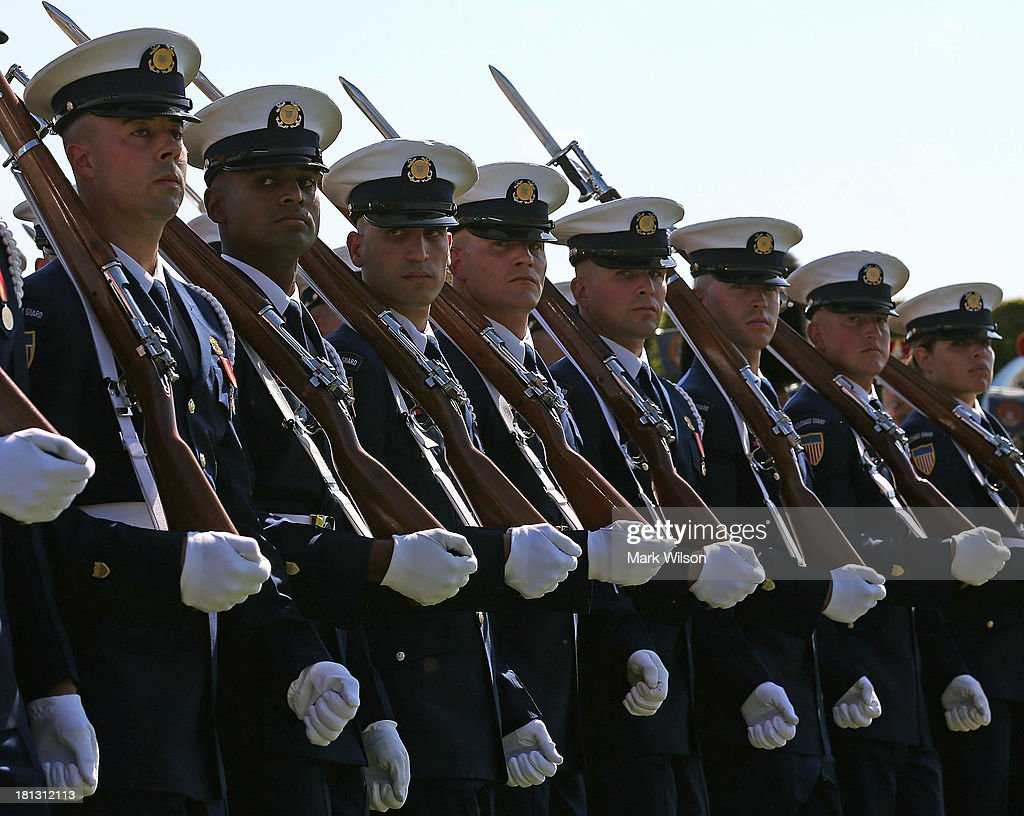 Members of the US Coast Guard march on the parade field during a ceremony to honor POW and MIA's at the Pentagon September 20 2013 in Arlington...