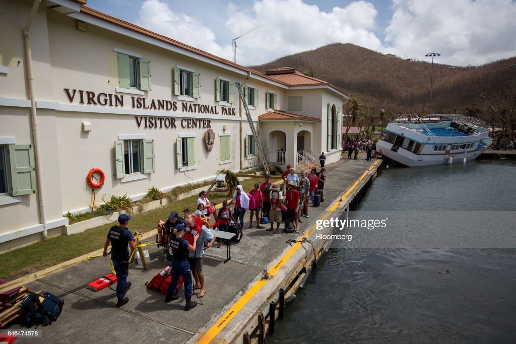 Members of the U.S. Coast Guard process evacuees after Hurricane Irma in St John, U.S. Virgin Islands, on Tuesday, Sept. 12, 2017. After being struck by Irma last week, the U.S. Virgin Islands couldn't look less like a tourist destination. Many local residents are giving up and getting out after losing everything to the category 5 storm,even as the local authorities in the U.S. territory say they are determined to rebuild the islands. Photographer: Michael Nagle/Bloomberg via Getty Images