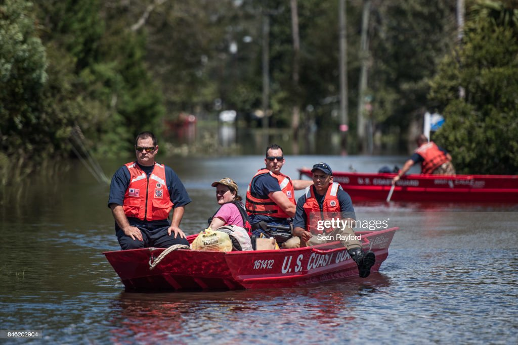 Members of the U.S. Coast Guard rescue a woman from flood waters caused by Hurricane Irma Sept. 12, 2017 in Hastings, Florida, United States. The storm brought flooding to areas not seen in generations.