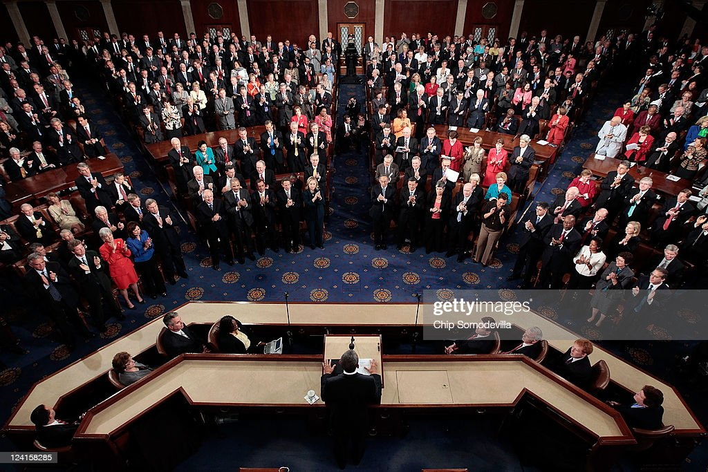 Members of the U.S. Congress applaud as U.S. President <a gi-track='captionPersonalityLinkClicked' href=/galleries/search?phrase=Barack+Obama&family=editorial&specificpeople=203260 ng-click='$event.stopPropagation()'>Barack Obama</a> (bottom) addresses a Joint Session at the U.S. Capitol September 8, 2011 in Washington, DC. Obama addressed both houses of the U.S. legislature to highlight his plan to create jobs for millions of out of work Americans.