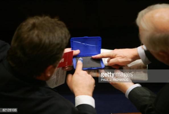 Members of the US Congress roll their right index fingers in blue ink to show solidarity for the recent Iraqi elections prior to the State of the...