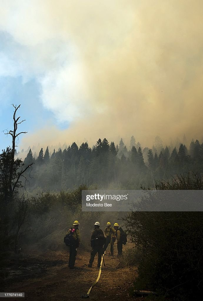 Members of the U.S. Forest Service firefighting crew work to control hot spots at the Rim Fire in the Stanislaus National Forest in California, Tuesday August 20, 2013.