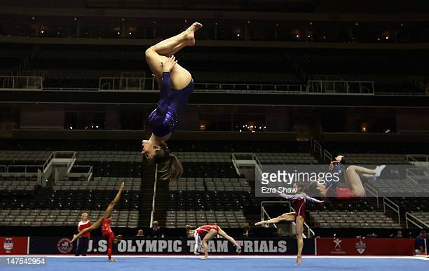 Members of the US gymnastics team including Jordyn Wieber practice on the floor before the start of competition on day 4 of the 2012 US Olympic...