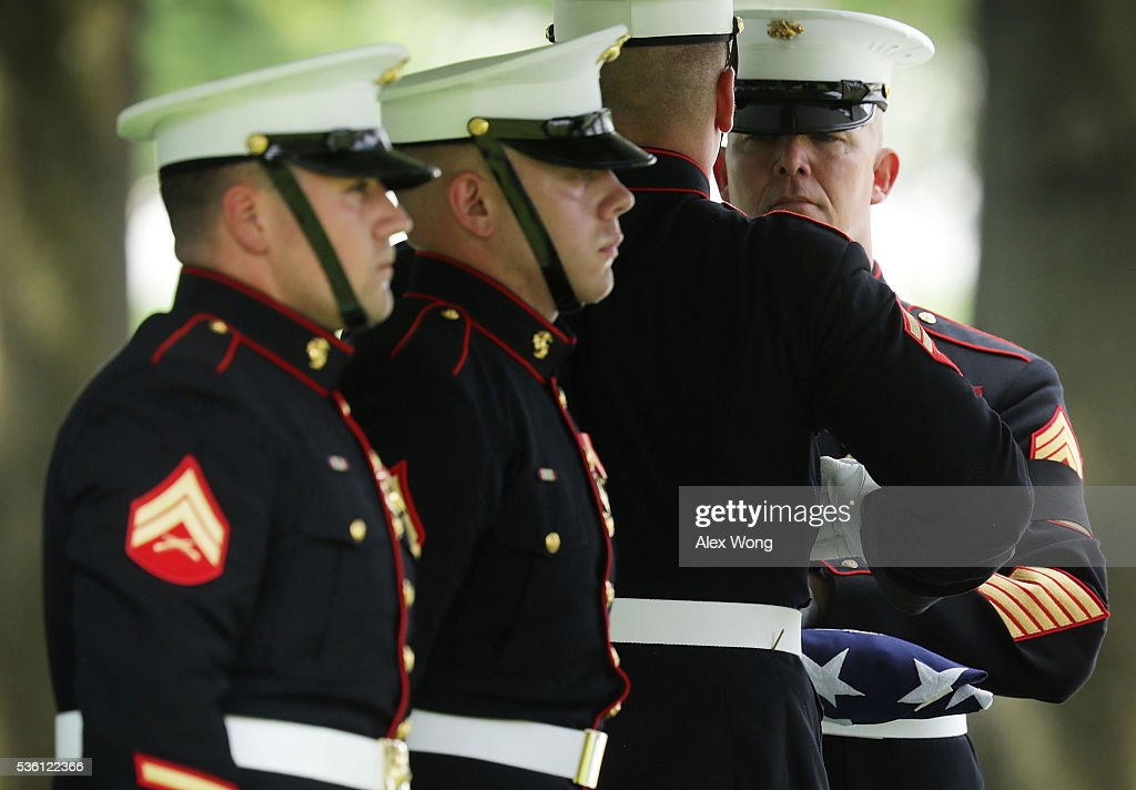 Members of the U.S. Marine Corps fold a flag during the burial of Private First Class James Bernard Johnson May 31, 2016 at Arlington National Cemetery in Arlington, Virginia. Johnson was assigned to Company K, 3rd Battalion, 8th Marines, 2nd Marine Division during WWII. He died sometime on the first day of battle against the Japanese, November 20, 1943, in an attempt to secure the small island of Betio in the Tarawa Atoll of the Gilbert Islands after landing.