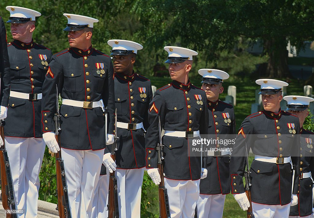 Members of the US Marine Corps Honor Guard stand on the stairs preparing for the arrival of Mexican President Felipe Calderon at the Tomb of the Unknown Soldier on May 20, 2010 at Arlington National Cemetery in Arlington, Virgina. AFP Photo / Paul J. Richards