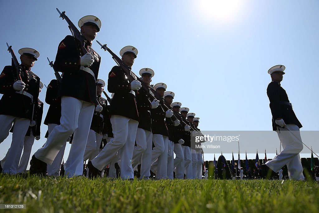 Members of the US Marines march on the parade field during a ceremony to honor POW and MIA's at the Pentagon September 20 2013 in Arlington Virginia...