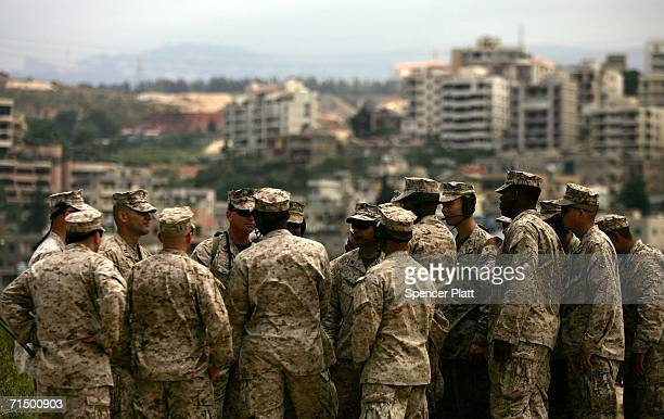 Members of the US Marines stand on the beach while assisting American nationals who are being evacuated from Beirut July 22 2006 in Beirut Lebanon...