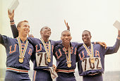 Members of the US men's 400 meter relay team pose with their gold medals after victory ceremonies during the 1964 Summer Olympic Games in Tokyo Japan...