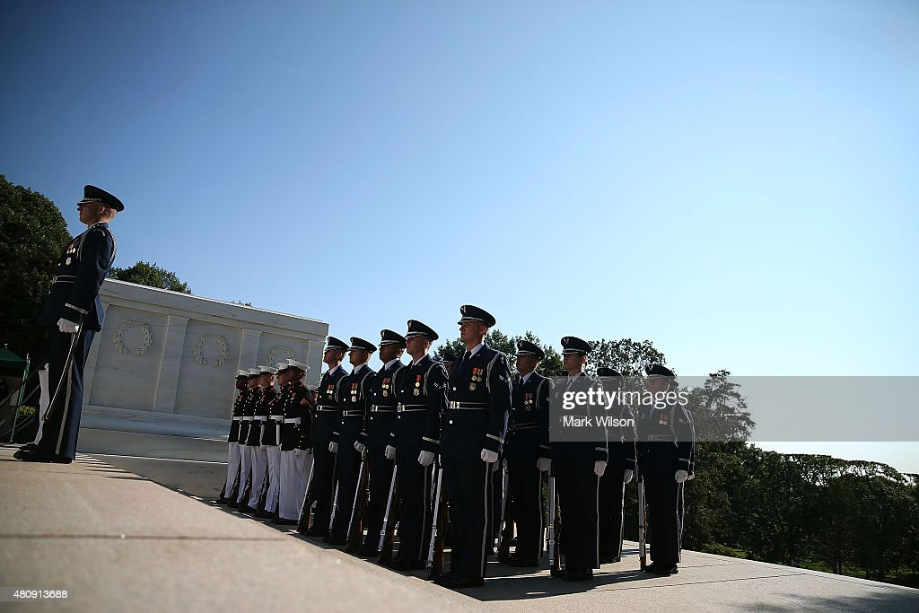 Members of the US military honor guard participate in a wreath laying ceremony at the Tomb of the Unknown Soldier July 16 2015 in Arlington Virginia...