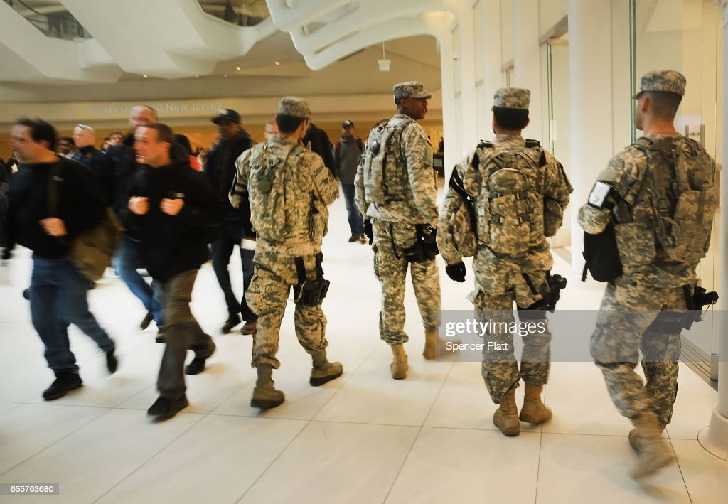 Members of the U.S. Military walk on patrol at the Westfield World Trade Center in Manhattan on March 20, 2017 in New York City. Senate Minority Leader Chuck Schumer has been voicing criticism of President Donald Trump's proposed budget that could cut as much as $190 million from New York City efforts to fight terrorism. Following two major terrorist attacks and numerous foiled plots, New York City is considered the nation's prime target for terrorists. The NYPD has stated that it costs $500,000 a day to pay for the nearly 200 police officers in and around Trump Tower on Fifth Ave.