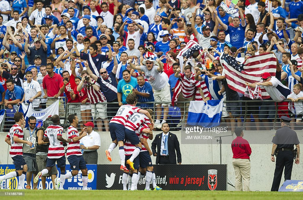 Members of the US national team celebrate after Clarence Goodson scored a goal in the first half of a CONCACAF Gold Cup quarterfinal match in Baltimore on July 21, 2013. AFP PHOTO/JIM WATSON