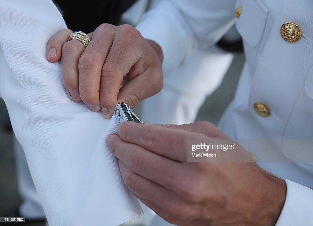 Members of the U.S. Naval Academy's class of 2016 make last minute uniform preparations before graduation ceremonies at the U.S. Naval Academy May 27, 2016 in Annapolis, Maryland. US Secretary of Defense Ashton Carter is this year's commencement speaker.