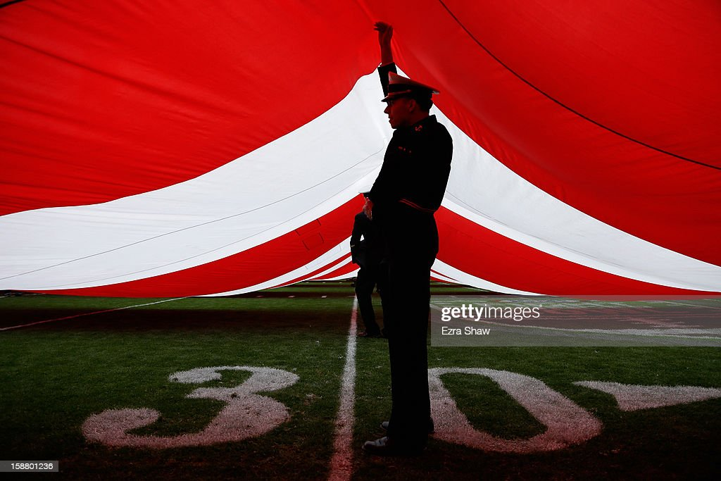 Members of the US Navy Academy hold the American flag during the playing of the National Anthem before the Kraft Fight Hunger Bowl between the Arizona State Sun Devils and the Navy Midshipmen at AT&T Park on December 29, 2012 in San Francisco, California.