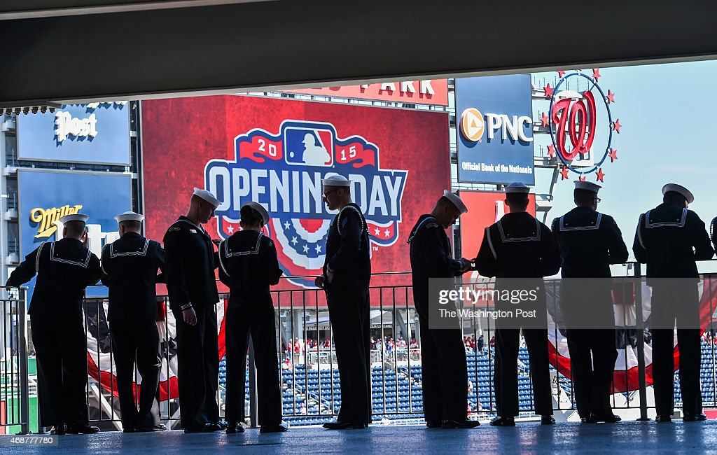 Members of the U.S. Navy Ceremonial Guard, of Washington, D.C., stand on the upper platform before their ceremonies on the field before the Opening Day game between the New York Mets and Washington Nationals at Nationals Park on April 6, 2015 in Washington, D.C.