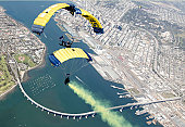 Coronado, California, March 16, 2011 - Members of the U.S. Navy parachute demonstration team, the Leap Frogs, perform a T-formation during a training jump above Naval Amphibious Base Coronado.