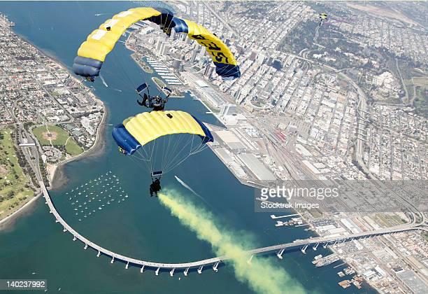 Members of the U.S. Navy parachute team above Naval Amphibious Base Coronado.