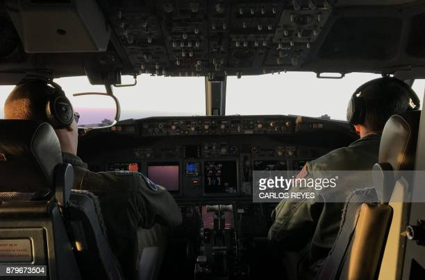 Members of the US Navy Patrol and Reconnaissance Wing 11 fly on a P8A Poseidon aircraft assisting the Argentine military in their search for the...
