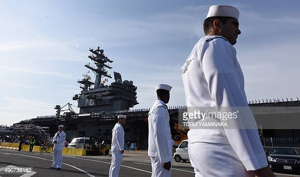 Members of the US Navy welcome aircraft carrier USS Ronald Reagan as she arrives at the US Navy base in Yokosuka a suburb of Tokyo on October 1 2015...