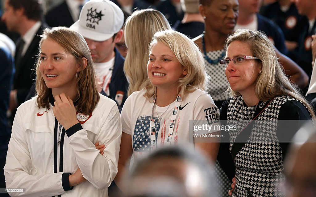 Members of the U.S. Olympic team listen as U.S. President <a gi-track='captionPersonalityLinkClicked' href=/galleries/search?phrase=Barack+Obama&family=editorial&specificpeople=203260 ng-click='$event.stopPropagation()'>Barack Obama</a> speaks during an event honoring the 2014 Olympic and Paralympic teams at the White House April 3, 2014 in Washington, DC. Obama congratulated the Olympians and Paralympians on their performance and thanked them for representing the U.S. during the 2014 Olympic Winter Games in Sochi, Russia.