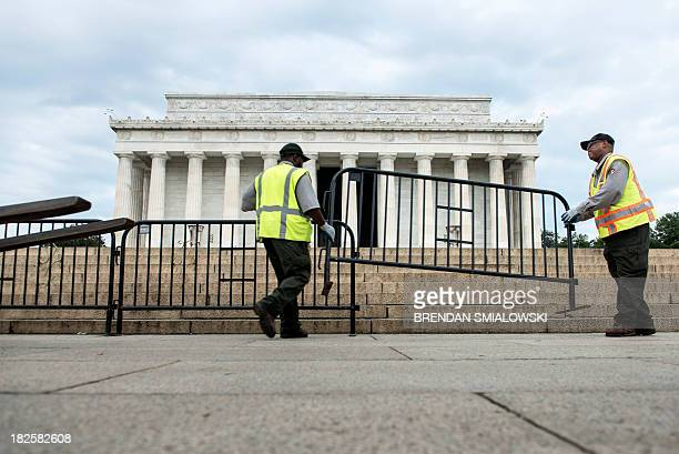 Members of the US Park Service close the Lincoln memorial on the National Mall October 1 2013 in Washington DCThe United States lurched into a...