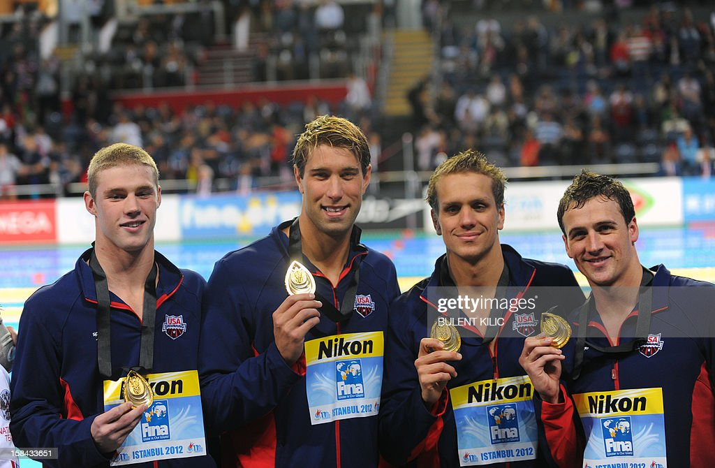 Members of the US relay team (L-R) Kevin Cordes, Thomas Shields, Matthew Grevers, Ryan Lochte pose on the podium after winning the men's 4x100m medley relay final during the Short Course Swimming World Championships in Istanbul on December 16, 2012.
