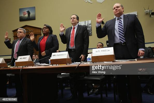 Members of the US Secret Service Protective Mission Panel Mark Filip Danielle Gray Thomas J Perrelli and Joseph Hagin are sworn in during a hearing...