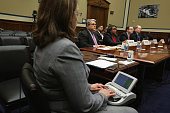 Members of the US Secret Service Protective Mission Panel Mark Filip Danielle Gray Thomas J Perrelli and Joseph Hagin testify during a hearing before...