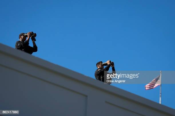 Members of the US Secret Service stand on the roof of the West Wing prior to the arrival of Prime Minister of Greece Alexis Tsipras to the White...